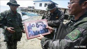 Family photo shown by police to reporters in Zamboanga city in the southern Philippines July 12, 2011
