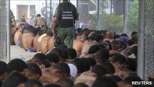 Inmates sit in El Rodeo prison in Guatire - scene of violent disturbances in June - photo 17 June 2011.