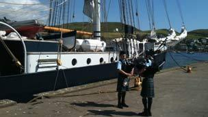Pipers beside Tall Ship