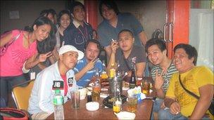 Jaycee Solis with his friends in the bar after work - at 7am