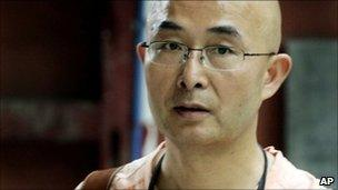 n this June 6, 2008 file photo, Chinese poet and novelist Liao Yiwu revisits the earthquake-damaged Gu Temple in Jiezi town of Sichuan province