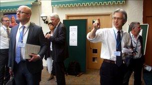 Iceland's Tomas Heidar and Japan's Joji Morishita, with other delegates