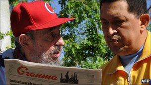 Venezuelan President Hugo Chavez Frias (R) and Cuban former President Fidel Castro reading Communist Party newspaper Granma, in Havana on 28 June 2011