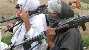 Taliban fighters peacefully surrender their arms during a meeting with Afghan government officials as part of the government's peace and reintegration process, 11 April 2011
