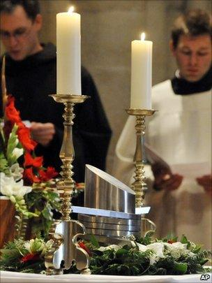 Hungarian monks pray in front of the heart urn of Otto von Habsburg during the requiem at the Benedictine Abbey of Pannonhalma in Hungary
