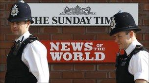 Police outside News International head quarters in the UK