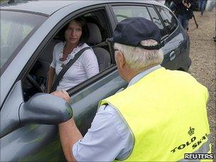 Danish customs officer checks car on Danish-German border, 5 July 11