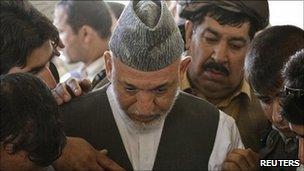 President Hamid Karzai at funeral. 13 July 2011