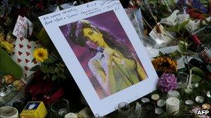 Flowers, pictures and messages are left in tribute to Amy Winehouse