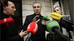 Papal Nuncio Archbishop Giuseppe Leanza speaks to the media as he leaves the Department of Foreign Affairs in Dublin