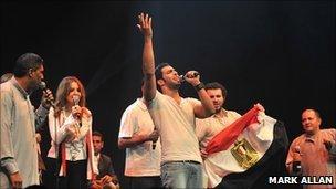 Azza Balba, Ramy Essam and members of El Tanbura