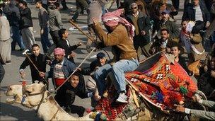 Pro and anti-Mubarak forces clash in Tahrir Square