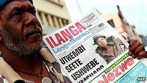 Newspaper vendor in South Africa