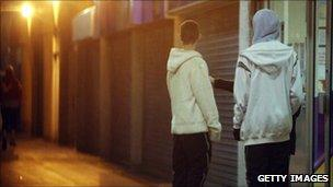 Young men outside a shop