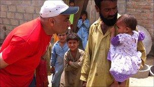 Habib Malik with Khatija, who was born during the floods