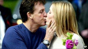 Sir Paul McCartney and his then fiancee Heather Mills, pictured in June 2002