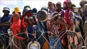 Internally displaced Somalis wait to receive food aid rations at the government-run Badbaado camp (file image from 28 July 2011)