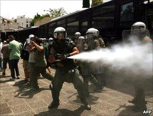 Greek riot police clash with taxi drivers in Athens, July 2011