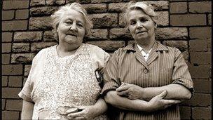 Two ladies share an orange