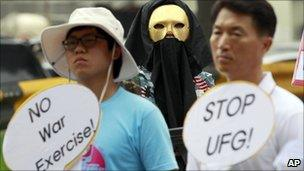 South Korean protesters participate in a rally denouncing a South Korea-US Combined Forces Command military exercise in Seongnam, south of Seoul, on Tuesday