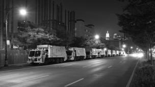 Garbage trucks lined up at night