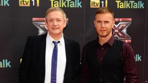 Louis Walsh and Gary Barlow pose on the red carpet for the new series of The X Factor.