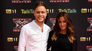 Olly Murs and TV presenter Caroline Flack attend the launch of the 2011 X Factor.
