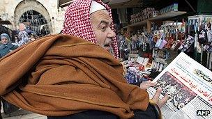 Newspaper reader in Jerusalem
