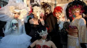 Faces hidden behind masks at the Venice Carnival