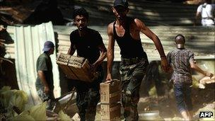 Libyan rebels seize ammunition buried underground by forces loyal to Muammar Gaddafi