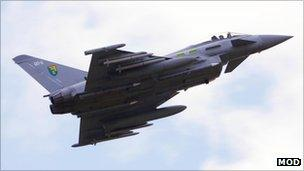 RAF Typhoon jet fighter flying over the Italian Airforce base of Gioia del Colle near Bari in southern Italy to patrol the no-fly-zone over Libya