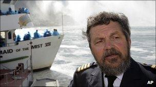 Captain Malcolm Bunting in front of the Maid of the Mist vessels