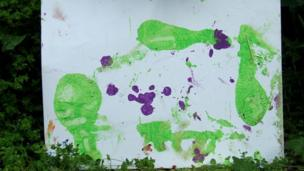 One of N'Dowe the lowland gorilla's paintings with green and purple paint.