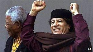 Col Muammar Gaddafi with Nelson Mandela (archive shot)