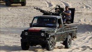 Anti-Gaddafi fighters patrol near the town of al Washka some 140km (87 miles) west of Sirte.