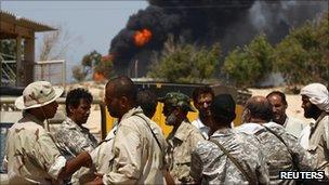 Rebels outside an oil refinery