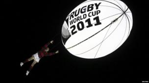 During the show, schoolboy Ethan Bai was hoisted 20 metres into the air to catch a huge glowing rugby ball.