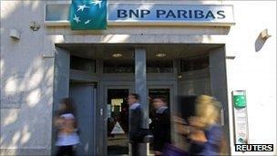 People walking past BNP Paribas