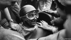 Argentinian racing driver Juan Manuel Fangio (1911 - 1995) wins the British Grand Prix at Silverstone, 14t July 1956