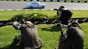 Photographers take pictures at the Goodwood Revival