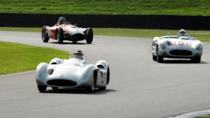 Three racing cars on the track at Goodwood