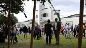 People gather at the exhibition area at Goodwood