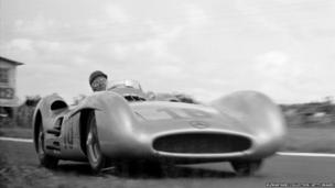 Fangio is at the wheel of his Mercedes-Benz W196 Streamliner at the the French Grand Prix in Reims.