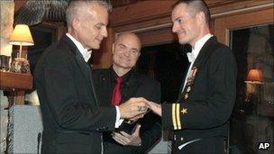 Navy Lt. Gary Ross, right, and Dan Swezy exchange wedding vows on 20 Sept 2011 in Vermont