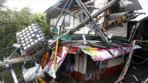 A house in Tondo city after an electric post slammed into it