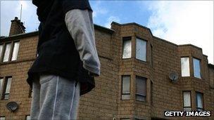 boy outside a home