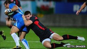 Scott Williams of Wales tackles Piet Van Zyl of Namibia during the IRB 2011 Rugby World Cup Pool D match