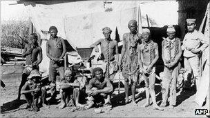 A soldier supervises chained prisoners during Germany's 1904-1908 war on the Herero and Nama