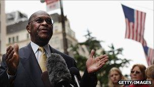 Herman Cain speaks to the media in New York City on 3 October 2011