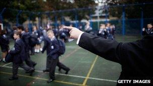 A teacher pointing at pupils